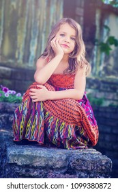Elegant little blonde girl posing for the camera