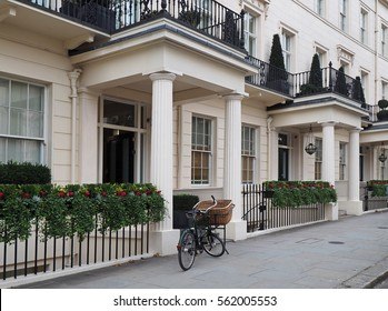 Elegant London townhouses and delivery bicycle