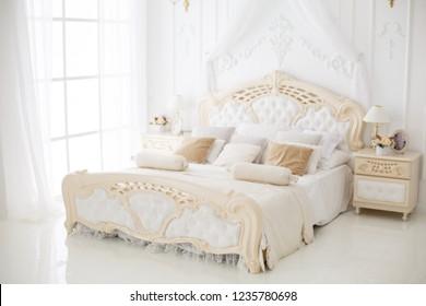 Elegant luxury bedroom. White interior