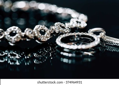 Elegant luxury bridal jewerly on dark background. Wedding details