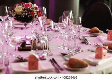 Elegant luxury cutlery and tablewear with flowers at hotel wedding reception