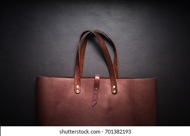 Elegant Luxury Leather Brown Bag Black Background Rich Accessories One Object Flat Lay Top View Sales Fashion Concept