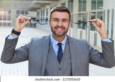Elegant male excited with his new pair of spectacles