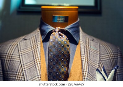 Elegant male suit on shop mannequins high fashion retail display