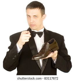 The elegant man in a classical tuxedo prefers the best model of footwear