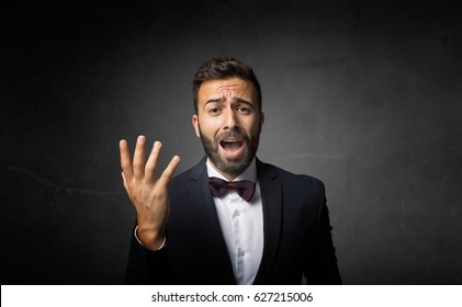 elegant man dramatic singing, dark background