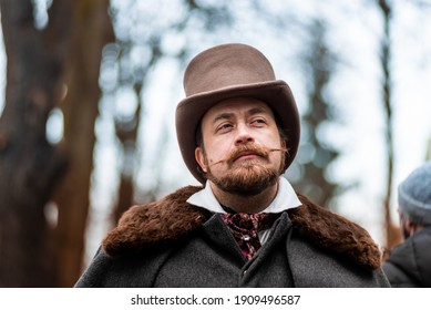Elegant man. The gentleman in a coat and a top hat