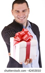 Elegant man with a gift, isolated in white background