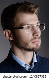 Elegant man in glasses. Optics style for men. Handsome businessman in spectacles. Male beauty, fashion.