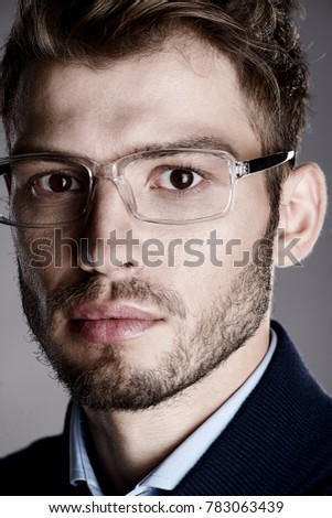 936afbf39234 Elegant man in glasses. Optics style for men. Handsome businessman in  spectacles. Male