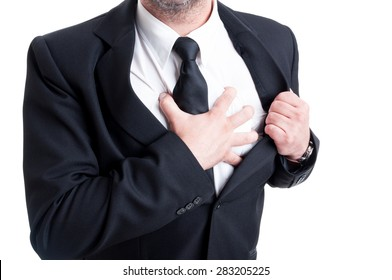 Elegant man having chest pain and heart attack while grabbing the shirt