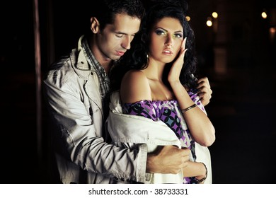 Elegant man holding an beautiful lady on the night