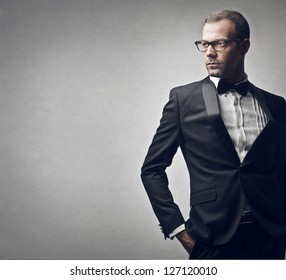 elegant man on a gray background