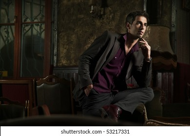 Elegant man posing in a stylish interior