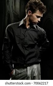 Elegant man posing in a stylish interior