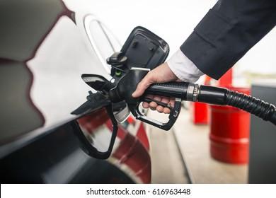 elegant man refuel at the gas station