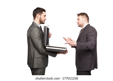 elegant man showing a briefcase to an elegant man that is thinking what to do
