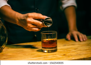 An elegant man suffering from alcoholism drinking whisky