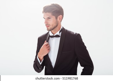 Elegant man in suit looking away