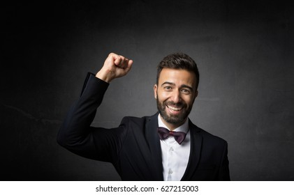 elegant man triumph, dark background