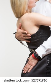 elegant man and woman in handcuffs. couple in love