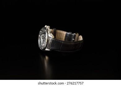 Elegant man's watch on black table