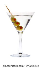 elegant martini glass with green olive and toothpick isolated on white