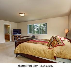 Elegant master bedroom with nice wood bed frame.