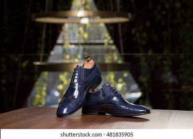 Elegant men blue shoes on beautiful background