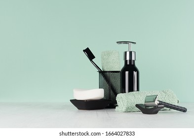 Elegant men dressing table in trend green mint menthe color - black razor, toothbrush, soap, towel, dispenser on  light white wood table.