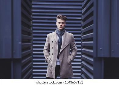 elegant men man in coat and scarf in urban style
