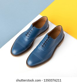 Elegant men's blue leather shoes on a color bright background