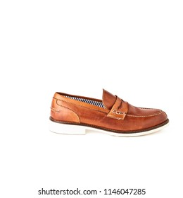 Elegant men's brown loafers shoes. Studio, white background