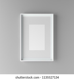 Elegant and minimalistic picture frame with parspartu standing on gray wall. Design element. 3D render