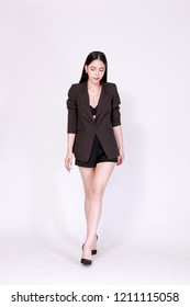 Elegant and modern Asian confident business woman in lookbook style isolated over white background