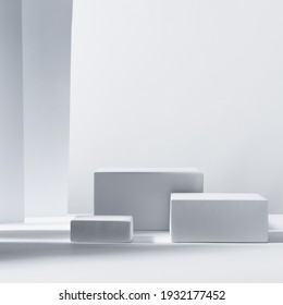 Elegant modern geometric style of showcase for cosmetics product display - white podiums as winner in sunlight with shadow in white background, square.