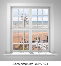 Elegant and Modern residential window with view of beach, palmtree, kite surfers and sea.