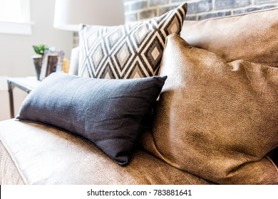 Elegant modern room closeup of leather couch and pillows in staging model house, home or apartment
