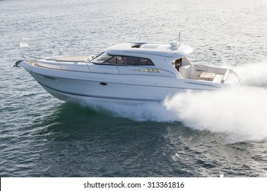 Elegant motor boat sailing at high speed on a sunny day