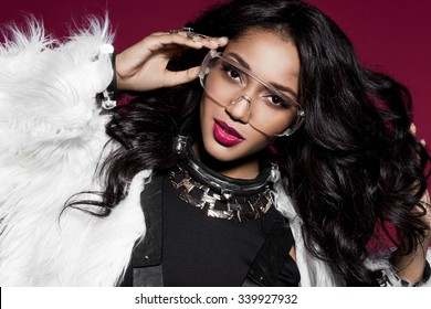 Elegant mulatto girl with fur