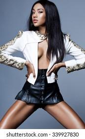 Elegant mulatto girl in a jacket