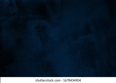 Elegant navy blue colored dark Concrete textured cool grunge abstract background with roughness and irregularities. 2020 color trend concept.