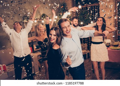 Elegant nice attractive charming beautiful cheerful well-dressed ladies and handsome groomed gentlemen at home festive, crazy funky night, chill out, glitter falling down