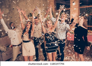 Elegant nice attractive charming beautiful gorgeous cheerful ladies and handsome gentlemen at home festive, crazy funky night, chill out, raising hans up, glitter falling down, flying
