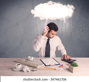 An elegant office worker is having a bad day while working, illustrated by a white cloud above his head with heavy rain and thunder concept