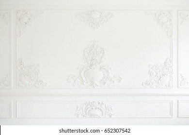 An elegant panel on a white wall made using stucco moldings
