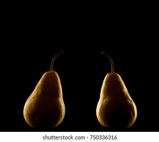 Elegant pear isolated on black background with backlighting