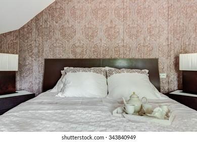 Elegant porcelain tea set on the bed