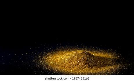 Elegant and precious sparkling golden powder pile on black background.