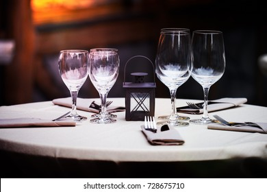 Elegant restaurant decoration with wine glasses and tables from the barrel